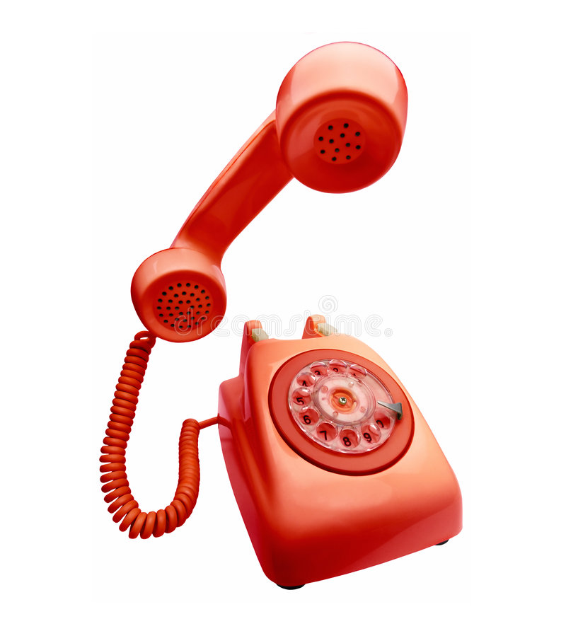 Red vintage telephone. With the handset on first plane royalty free stock image