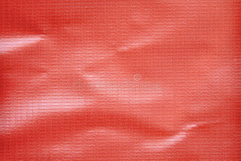 Red vinyl banner texture and background. Close up of red vinyl banner texture and background royalty free stock photos