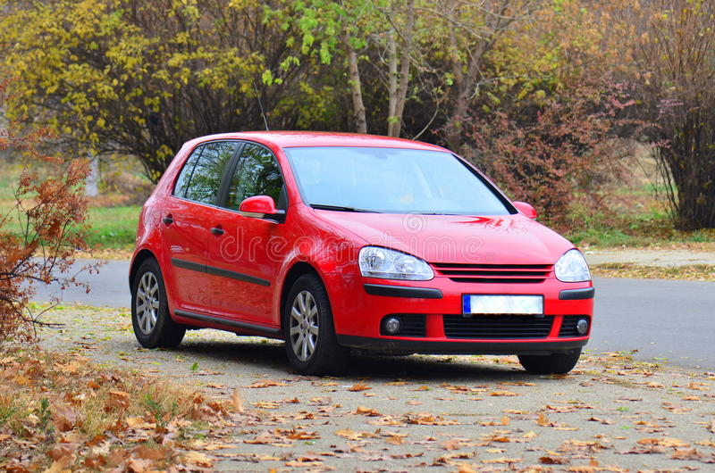 Red Volkswagen GTI Golf car. Bright red volkwagen golf car parked on the side of the road royalty free stock photo