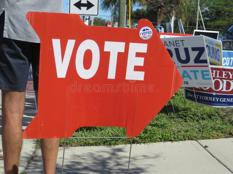 Vote sign, Tampa, Florida. Red vote sign displayed during early voting outside Jan Kaminis Platt regional library in south Tampa, Florida royalty free stock photography
