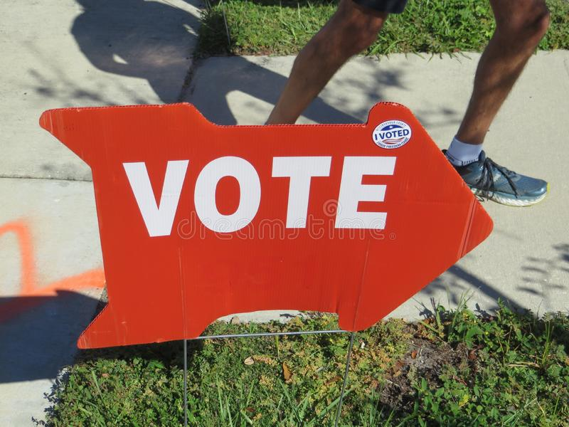 Vote sign, Tampa, Florida. Red vote sign displayed during early voting outside Jan Kaminis Platt regional library in south Tampa, Florida royalty free stock images
