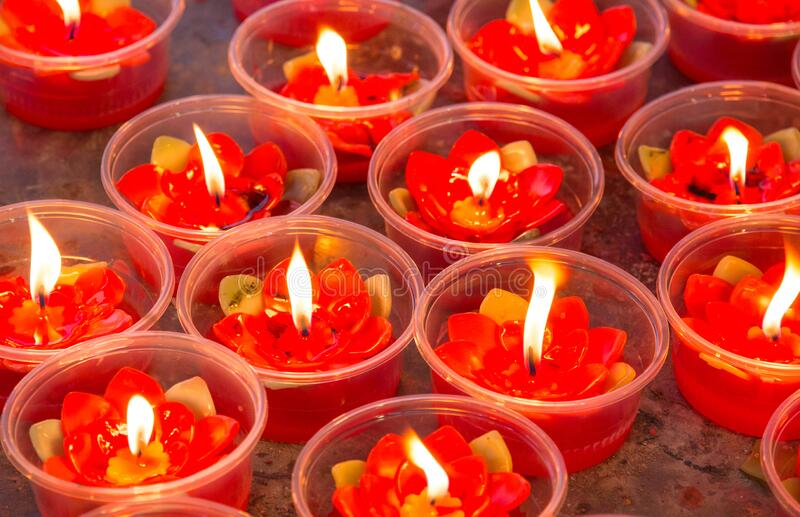 Red votive candles. In a church royalty free stock photo