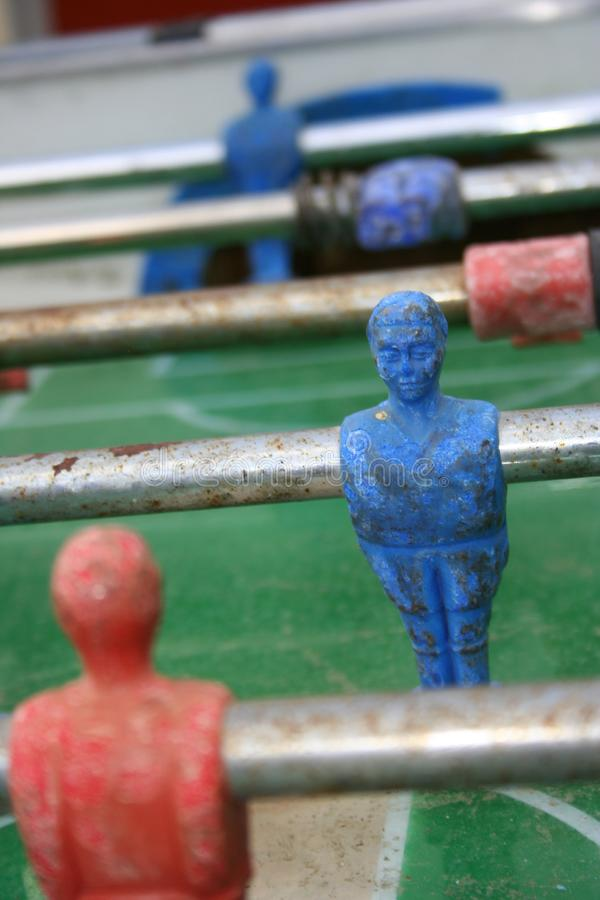 Red Vs Blue in table football. An old table football and its neverending rivalry/challenge royalty free stock image
