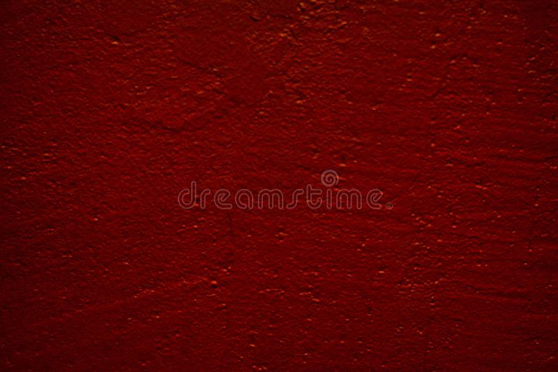 Red wall with irregularities stock images