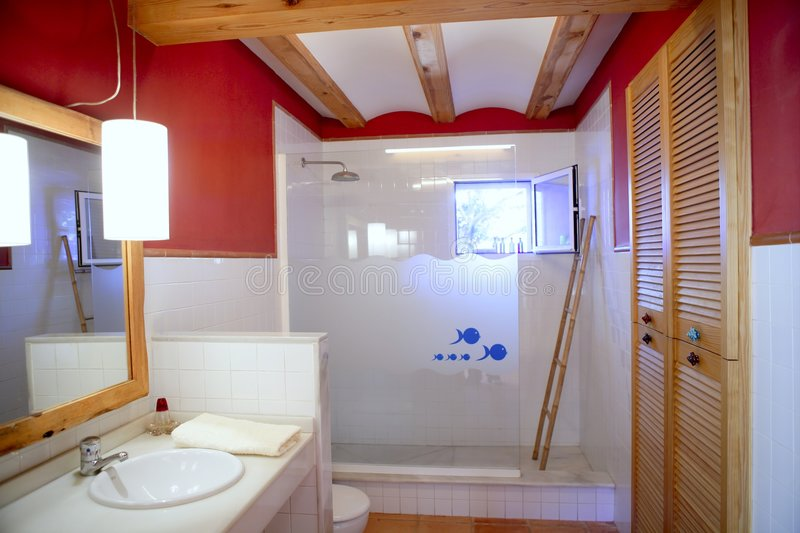 Red wall nice bathroom natural light interior stock photography