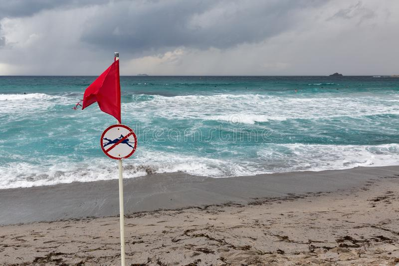Red warning flag on sea beach royalty free stock images