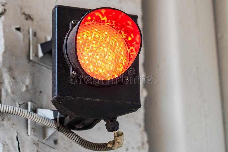 Red warning light at factory stock photo