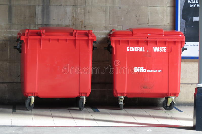 Red waste containers. DONCASTER, UK - CIRCA AUGUST 2015: Red waste containers aka Litter bin garbage bin trash bin or waste bin royalty free stock photo