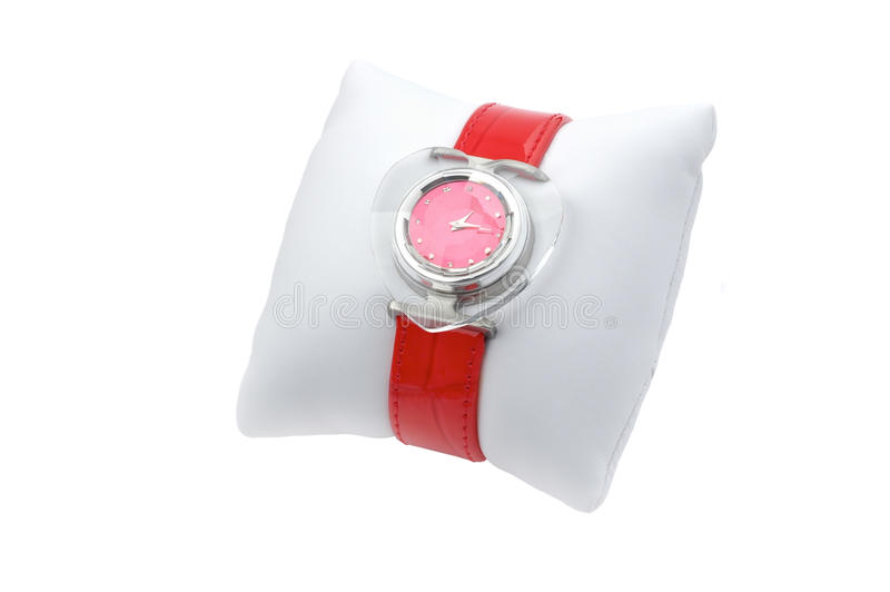 Red watches on gift pillow stock photography