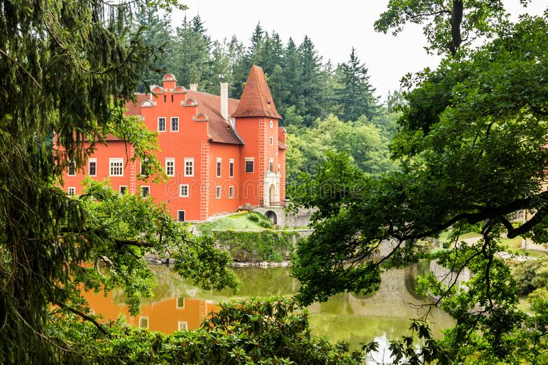 Cervena Lhota - the red, water chateau in the the Czech republic. stock photography
