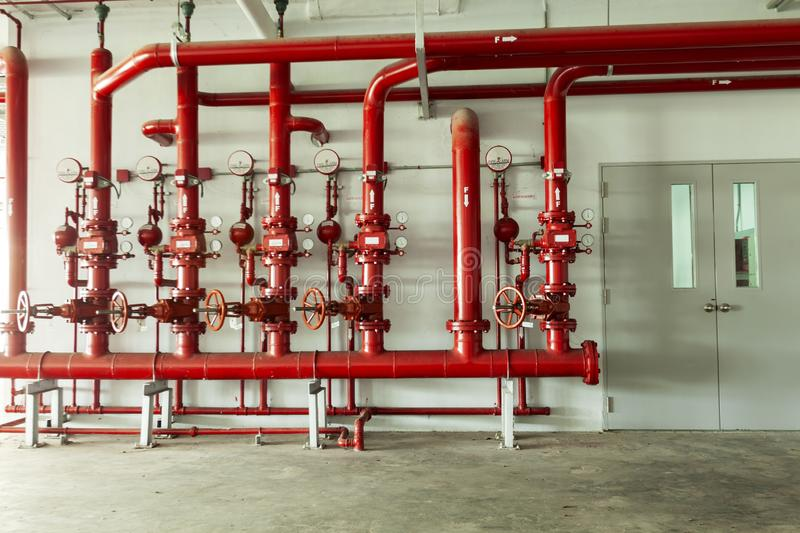 Red water pipe valve,pipe for water piping system control and Fire control system in industrial building or business building stock photography