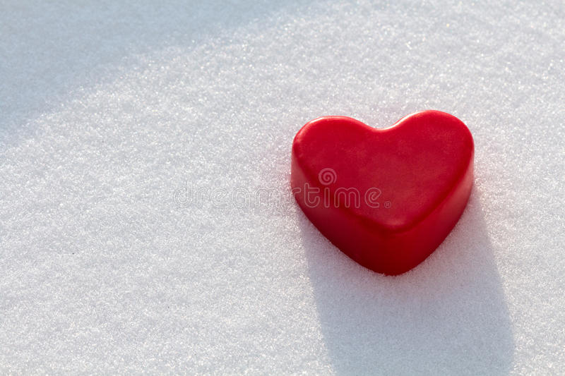 Red wax heart in the snow stock images