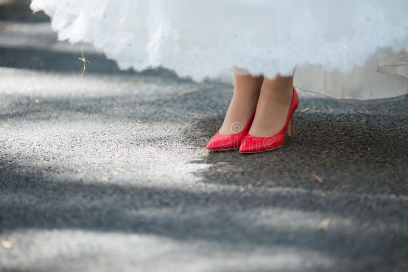 Red Wedding shoes. On the gatherings of the bride stock photo