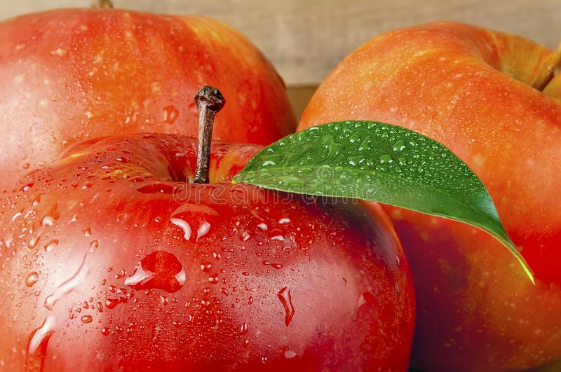 Red wet apple with big droplet, macro shot stock image
