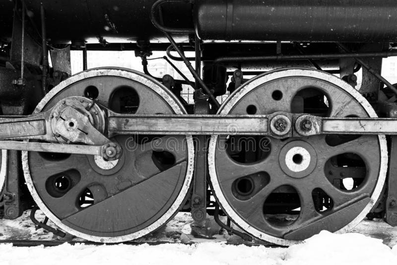 Red wheel and detail of mechanism a vintage russian steam train locomotive royalty free stock photo