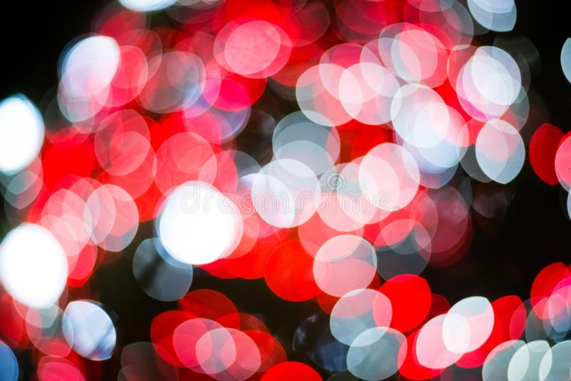Red and white abstract blurry light bokeh background for overlay. Anniversary and Celebration concept. New year festival and. Red and white abstract blurry light stock image
