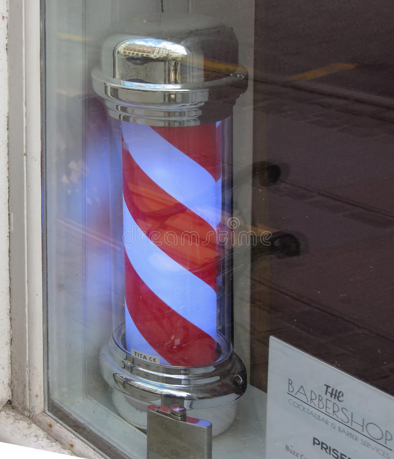 Red and white Barber`s pole royalty free stock photography