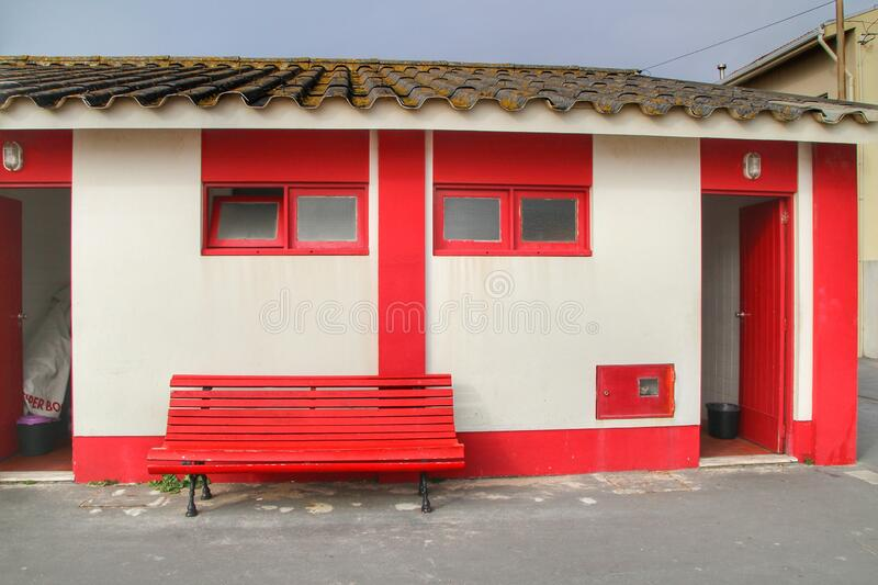 Red and white beach hut on the Aguda beach royalty free stock photography