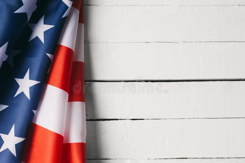 Red, white, and blue American flag for Memorial day or Veteran`s day background. On the white royalty free stock images