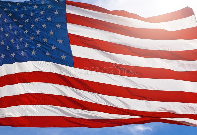 A Red White and Blue American Flag Waving in the Wind. Red White and Blue American Flag Waving in the Wind stock photos