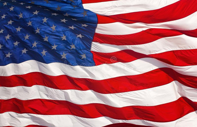 A Red White and Blue American Flag Waving in the Wind. Red White and Blue American Flag Waving in the Wind royalty free stock photography