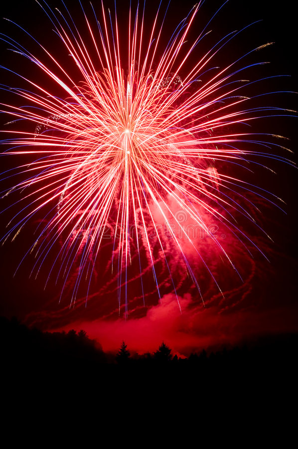 Red, white and blue fireworks on 4th of July royalty free stock photos