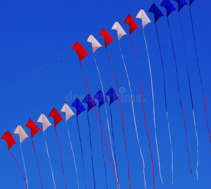 Red white and blue kites stock photos
