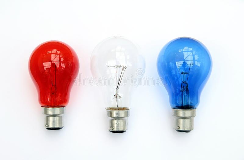 Red white and blue light bulbs in white background - patriotic flag concept stock images