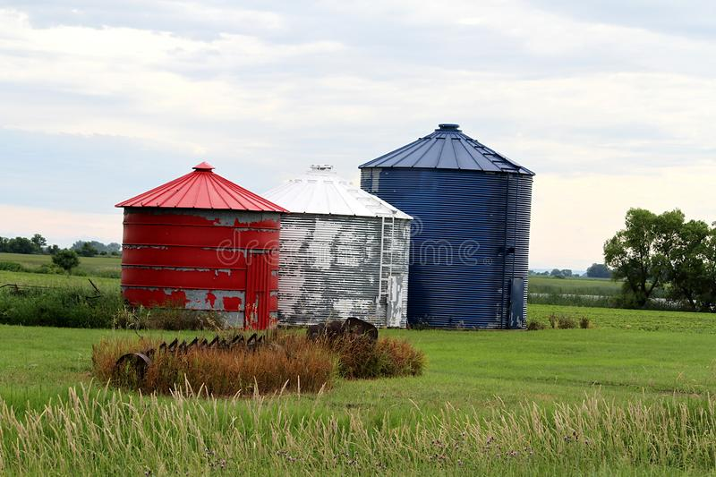 Red, white and blue patriotic farm grain bins. royalty free stock photos