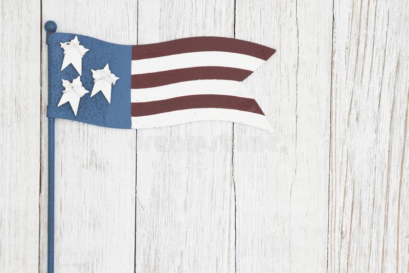 Red, white and blue retro American flag on weathered whitewash textured wood background royalty free stock photography