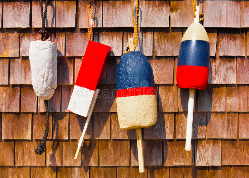 Red white and blue vintage fishing buoys stock photo
