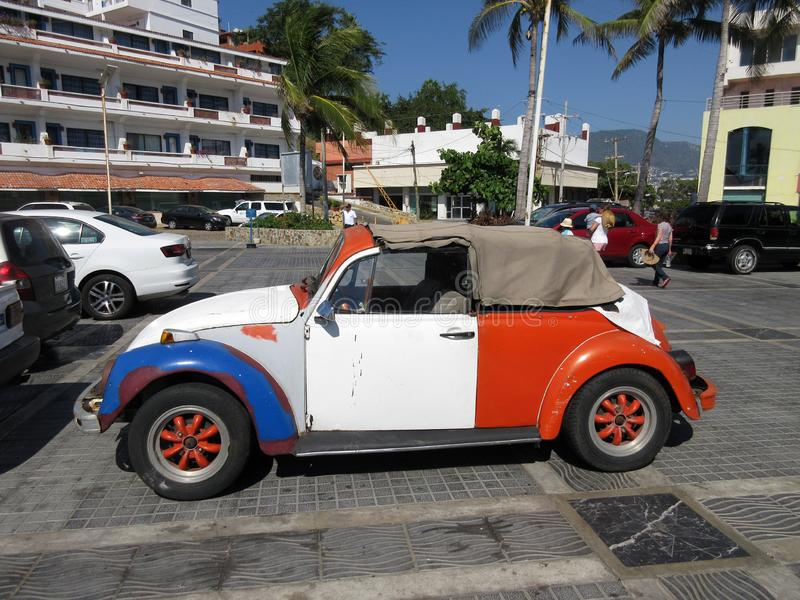 Red, White and Blue Volkswagen Beetle. Photo of red, white and blue volkswagen beetle in acapulco mexico royalty free stock photos