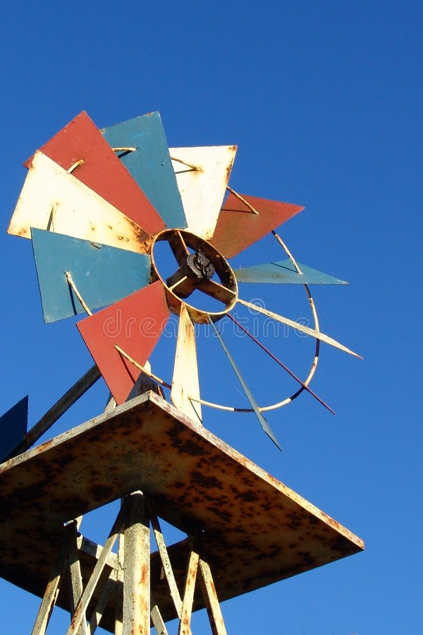 Red, white, and blue windmill and sky royalty free stock photo