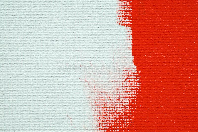 Red on a white canvas background. The surface of the abscess is bright red brush on the abstract image.  royalty free stock image