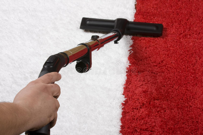 Red and White Carpet cleaning. Tube cleaner on the carpet stock photos