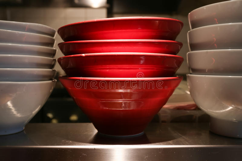 Red and white ceramic noodle bowl stock image