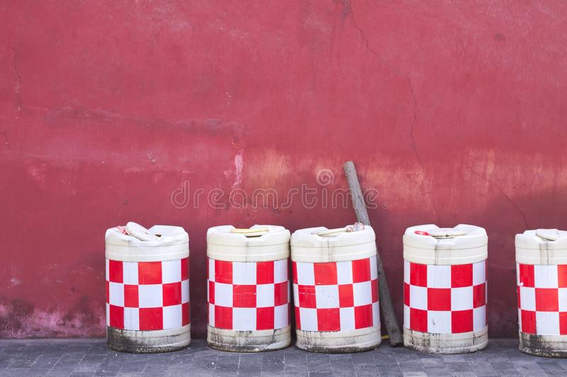 Red and white checkered tanks and a purple wall background. Kunming, Yunnan, China royalty free stock photos