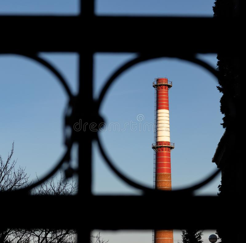 Red And White Chimney Of Power Plant Factory stock photography