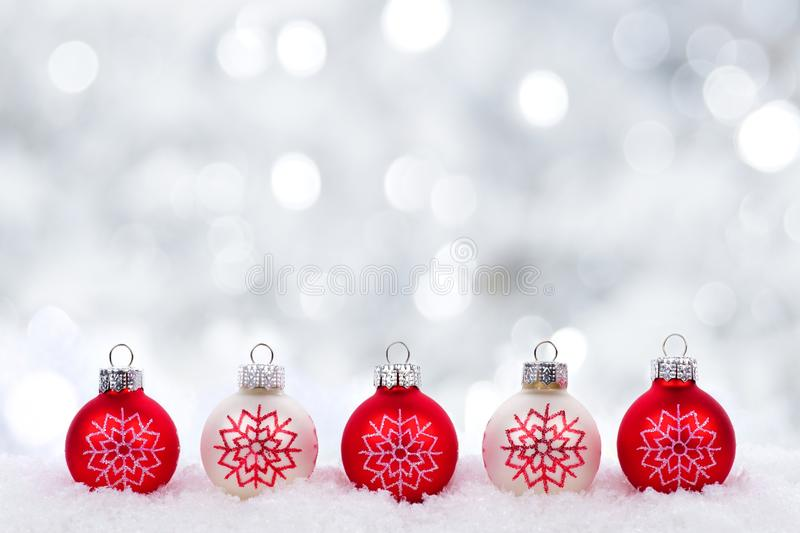Red and white Christmas ornaments with twinkling silver background royalty free stock photography