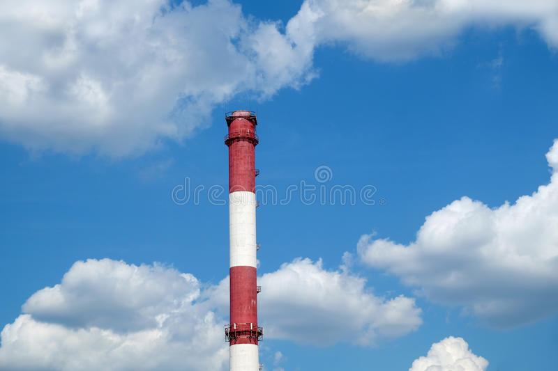 Red and white colored stripe industrial smoke pipe royalty free stock photo