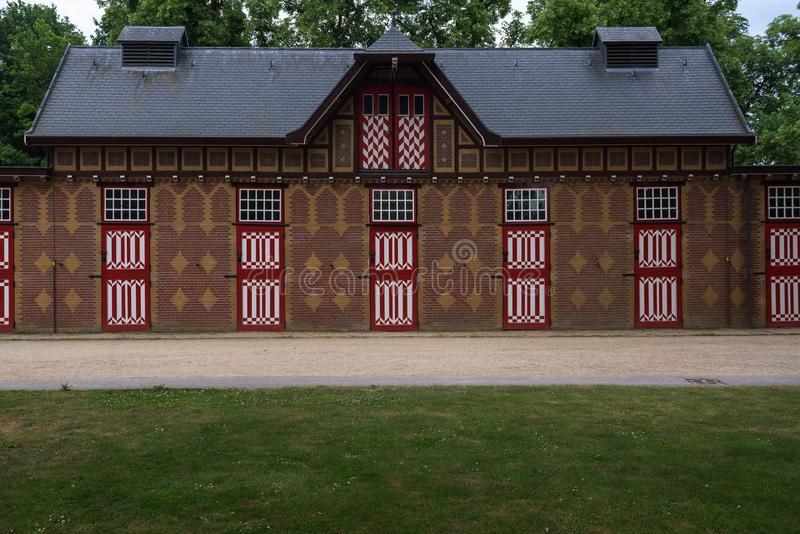 Red and white decorated doors of the stables of De Haar Castle. The red and white are the colors of the coat-of-arms of the family that owned the castle royalty free stock photo