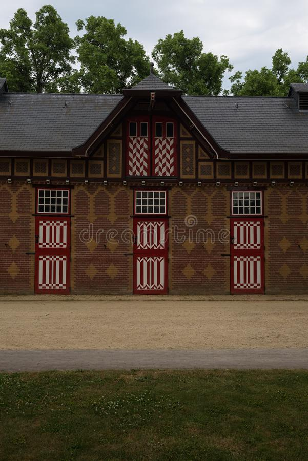 Red and white decorated doors of the stables of De Haar Castle. The red and white are the colors of the coat-of-arms of the family that owned the castle royalty free stock image