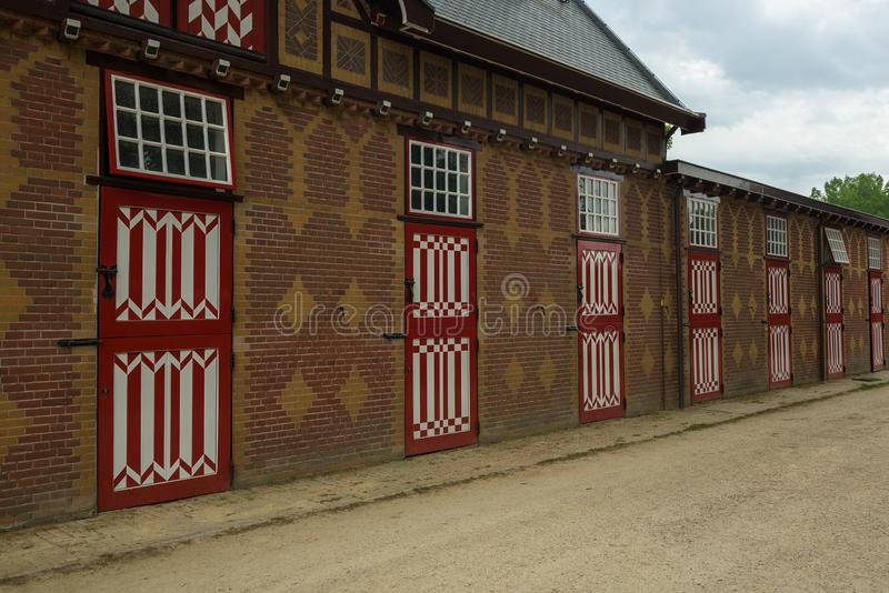 Red and white decorated doors of the stables of De Haar Castle. The red and white are the colors of the coat-of-arms of the family that owned the castle royalty free stock photos