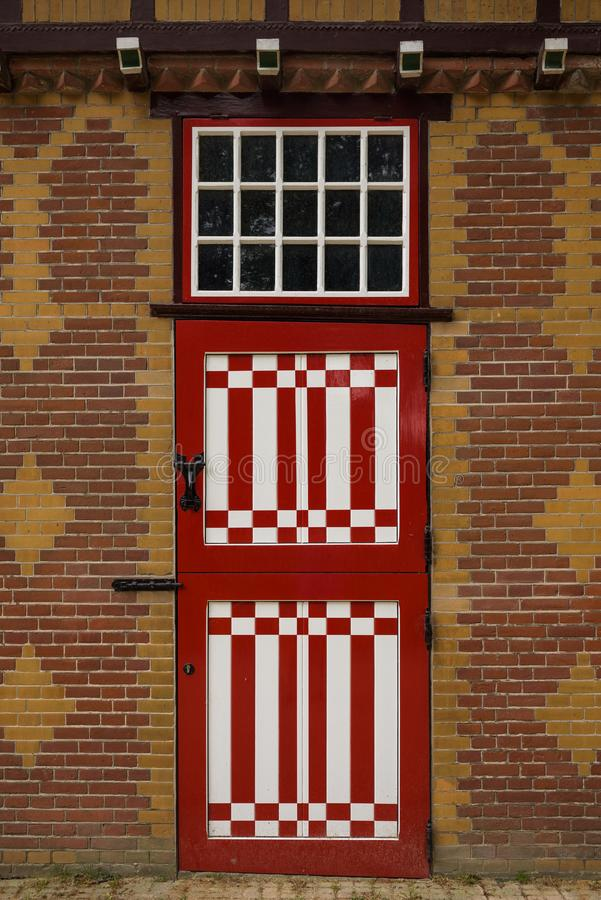 Red and white decorated doors of the stables of De Haar Castle. The red and white are the colors of the coat-of-arms of the family that owned the castle stock images