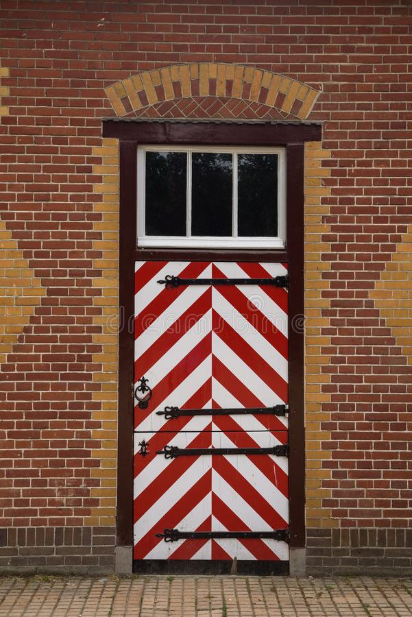 Red and white decorated doors of the stables of De Haar Castle. The red and white are the colors of the coat-of-arms of the family that owned the castle stock photography