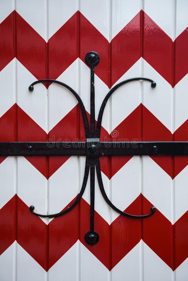 Red and white decorations on the doors and window shutters of De Haar Castle. The colors are derived from the family coat-of-arms of the Van Zuylen family stock photo
