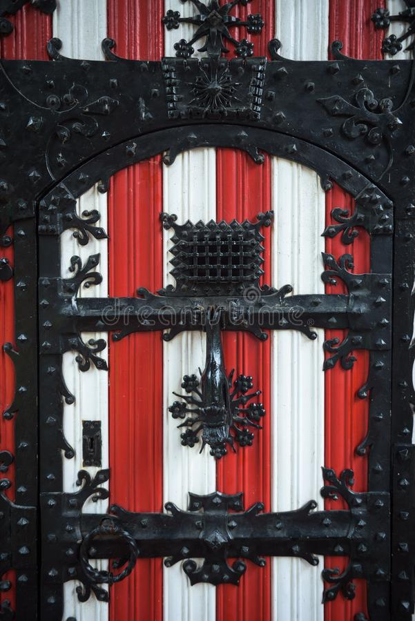 Red and white decorations on the doors and window shutters of De Haar Castle. The colors are derived from the family coat-of-arms of the Van Zuylen family royalty free stock image
