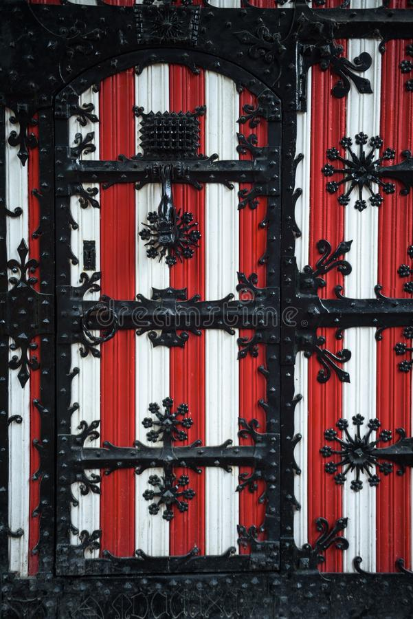 Red and white decorations on the doors and window shutters of De Haar Castle. The colors are derived from the family coat-of-arms of the Van Zuylen family royalty free stock photo