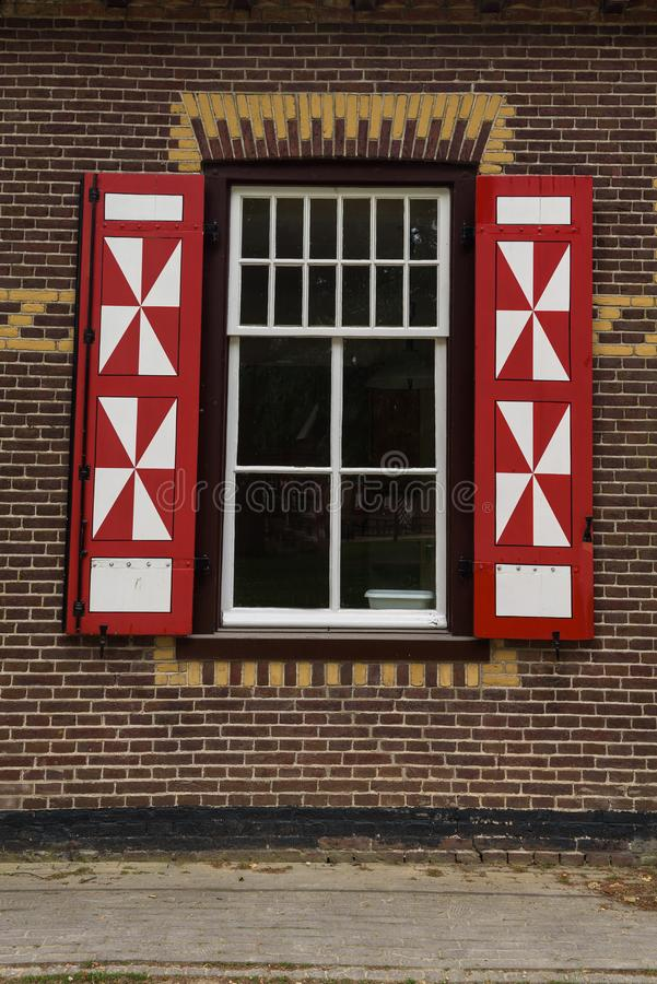 Red and white decorations on the doors and window shutters of De Haar Castle. The colors are derived from the family coat-of-arms of the Van Zuylen family royalty free stock photography
