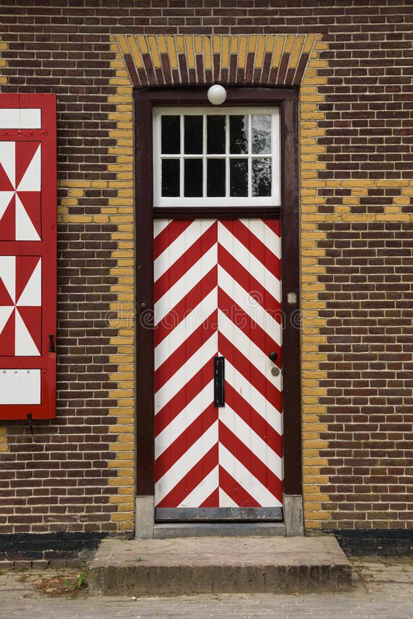 Red and white decorations on the doors and window shutters of De Haar Castle. The colors are derived from the family coat-of-arms of the Van Zuylen family stock image